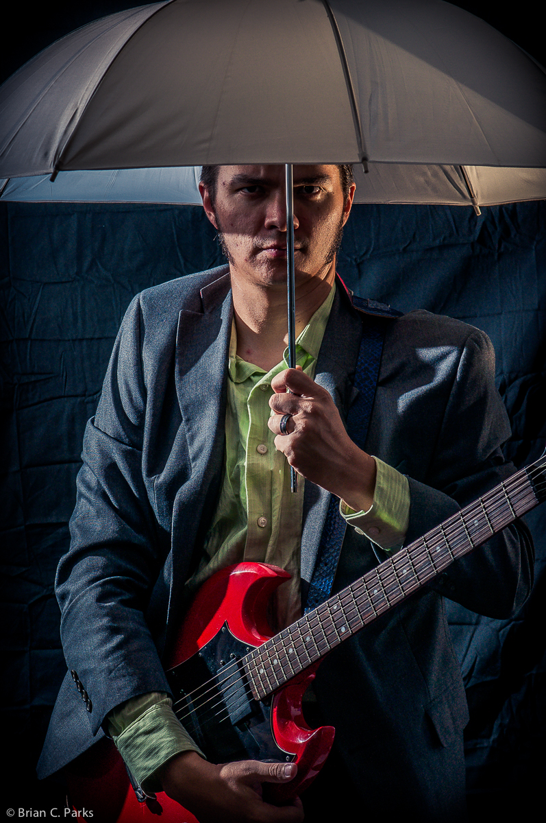 Self portrait with guitar and umbrella